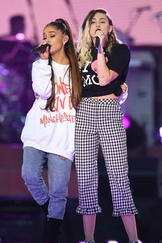 Ariana Grande and Miley Cyrus performing at One Love Manchester benefit concert