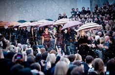 Clear plastic raindrops fall on the show's finale. #burberry #lfw
