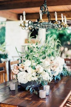 Wedding reception centerpiece idea; Featured Photographer: Taylor Lord Photography