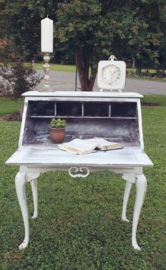 WHITE SECRETARY DESK PAINTED IN CRISP LINEN WHITE AND DISTRESSED FROM VINTAGE VISION FURNITURE IN HUDSON, NC.  SEE MORE AT:  http://www.facebook.com/vintagevisionstore