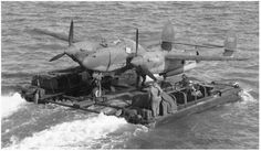 """The DUKW, also known as the """"Duck,"""" was a six-wheeled amphibious vehicle used in World War II by the US military for transporting good and personnel over Ww2 Aircraft, Military Aircraft, Lockheed P 38 Lightning, Amphibious Vehicle, Old Planes, Ww2 Pictures, Nose Art, Military History, Military Memes"""