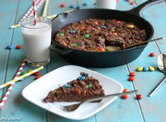 Gooey M&M Peanut Butter Chocolate Skillet Cake- melt in your mouth, amazingly- good, peanut-butter chocolate cake filled with dark chocolate m&ms baked in a skillet. Grain & gluten free. | Double Dose Fitness #grainfree#glutenfree