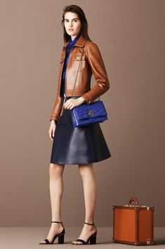 Bally Crucero 2016 brown leather jacket black leather skirt and ankle strap heels