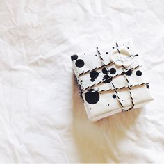 Black speckled paper and black and white gift twine.