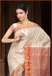 Off white and red traditional Handloom Saurnarchuri  pure silk oxidised golden zari and resham woven saree from Bengal. As shown blouse fabric can be made available and the same can be customized in your style or pattern, subject to fabric limitation, as the fabric is just drape on the model. (Slight variation in color is possible)