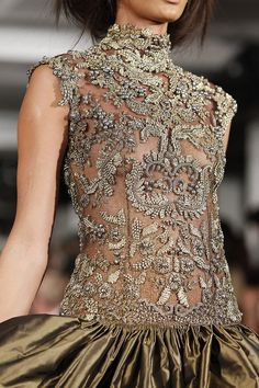 Baroque beaded style bust. Gold designer dress. alexander mcqueen