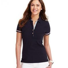 Navy polo with red trim Tommy Hilfiger Womens Contrast Trim Short Sleeves Polo Top. Washed once and never worn. Nwot. Gorgeous classy polo great for any event. Classy and preppy. Would be great with white jeans for a game of golf or a summer party. Fourth of July and Memorial Day must have! medium fit true to size! Navy blue with cute red design on sleeves. YES I bundleNO TRADES EVER no low balls. Don't ask to trade I will say no even if I love your closet. Negotiable ONLY USE OFFER BUTTON…