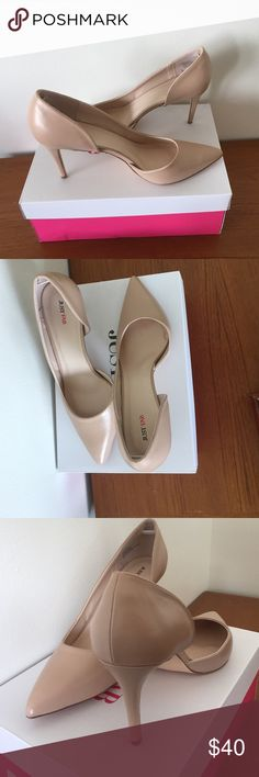 Never worn nude pumps by JustFab Gorgeous never worn nude pumps. Great show that can take you from work to drinks. These have never been worn and just removed from the box. There is a couple small bluish marks on the bed of the heels that are a manufacturing issue. JustFab Shoes Heels