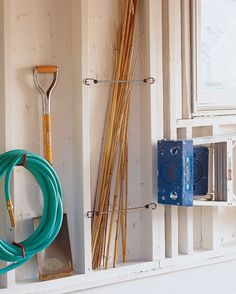 Bungie cords and push pins (?) to hold top-heavy, clumsy items against a corner or wall.