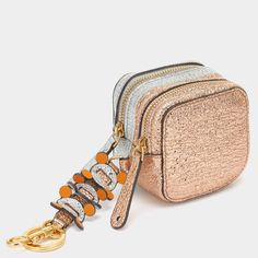Inspired by geometric shapes - especially the circle - the Spring Summer 2017 collection blends cutting edge technology with naive leathercraft to create intricate geometric designs. This handy coin purse can be hung inside or outside your bag and comes with an intricate leatherwork strap.  Item number: 5050925949163