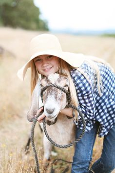 This girl is so cute with her goat. Maybe I will live on a farm and get a cute goat :)