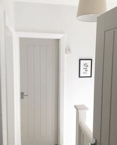 Farrow & Ball Paint – Purbeck Stone Grey is demure, on trend, and works wonderfully to add depth to this white hallway. It gives a modern finish to these vintage style doors and makes for a contemporary cottage look www. Grey Interior Doors, Interior Door Styles, Painted Interior Doors, Grey Doors, Home Interior Design, Cottage Doors Interior, Cottage Style Doors, Modern Cottage Style, Paint Doors