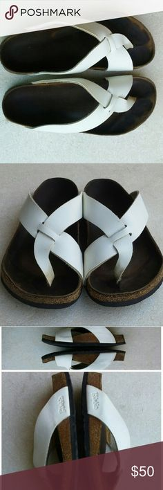 Birki's by Birkenstock shoes L8 M6 Preowned white shoes, cork has some cracks, eu size 39 us woman's 8 and man's 6  Original Birkenstock made in Germany  I'll add more pictures if requested. Thank you. Birkenstock Shoes Sandals