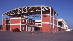 """CARBONORCA Service Buildings Complex, Architect Jorge Rigamonti, 1988-90, View of he Fire Station building showing the arc-shaped """"umbrella"""" roof"""