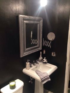 Black guest bathroom.  Satin black onyx paint added some valspar paint crystals for added depth.