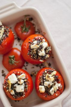 Mediterranean-inspired baked tomatoes, filled with quinoa, feta, artichokes and kalamata olives, make a beautiful, healthy side dish.