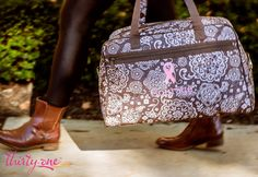 Raise awareness for Breast Cancer this October with a powder pink ribbon on this Thirty-One City Weekender in Brown Woodblock Floral. For every ribbon purchased 31 cents will be donated to Thirty-One Gives to support our mission to empower women and girls and strengthen families.    www.mythirtyone.com/lorikuramoto