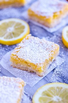 Lemon squares or lemon bars are easily made with a shortbread crust and a lemon custard layer baked on top. Finish with a sprinkle of confectioners sugar. My grandmother's recipe is a family favorite!