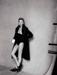 Kate Moss in a oversized coat and bodysuit // Photo by Peter Lindbergh for Vogue Italia