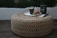 Sand-colored outdoor pouf, of crocheted polyester yarn that feels soft as cotton. The pouf is weatherresistant and so it can remain outside all year round. The crocheted cover is pulled over a rubber tire.