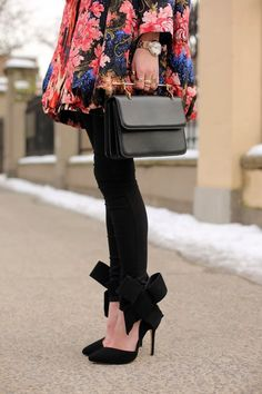 Jacket: Oscar De La Renta. Denim: 7FAM. Shoes: Aminah Abdul Jillil. Bag: M2Malletier. Rings: MMM, Cartier, Pomellato, David Yurman. Nails: Deborah Lippmann 'Fade to Black'.