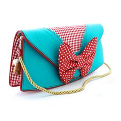 Lola Clutch Bag from Irregular Choice. Bright blue & checkered red & polkadot bow. Mmm... Love it.