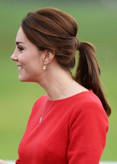 The Duchess wore her hair up in a stylish ponytail.
