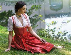 Elegant red dirndl with V-neck lace blouse