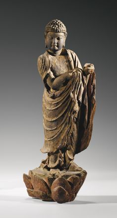 A RARE WOOD FIGURE OF BUDDHA, EARLY MING DYNASTY.