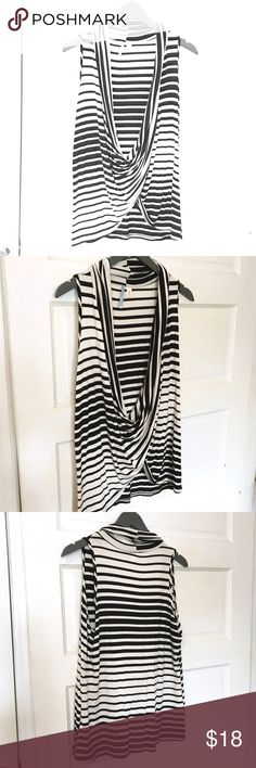 Black + white stripe top Black and white is always a classic! From the brand Moonlight, Purchased from Francesca's. Black and white stripes that enlarge as they move toward the hem. Sleeveless. Draped neckline. Looks great worn with a cami underneath, or even a long sleeved shirt. Can be worn causally or dressed up. Worn once! Great condition! Francesca's Collections Tops Tank Tops