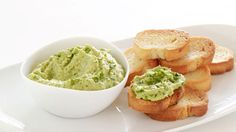 Fresh Pea Hummus Crostini With Pea Tendril Garnish Recipe | Bon Appetit