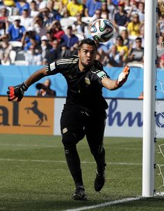 Argentina goalkeeper Sergio Romero gathers the ball from a free-kick during the World Cup round of 16 soccer match between Argentina and Switzerland at the Itaquerao Stadium in Sao Paulo, Brazil, Tuesday, July 1, 2014.