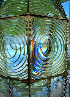 Thel brass & glass of the Fresnel Lens (made in France) of the Cape Blanco Lighthouse 7 miles north of Port Orford at Cape Blanco State Park on the southern Oregon coast . Cape Blanco is the western most point of land in Oregon. Candle On The Water, Southern Oregon Coast, Lighthouse Photos, Lighthouse Keeper, Beacon Of Light, Windmill, State Parks, Coastal, Around The Worlds