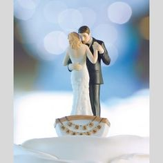 Whether your heart lies in the crystal blue waves of the ocean, or you're having a seaside wedding celebration, Sailing in an Embrace Wedding Cake Topper is sure to put a splash in your occasion. - See more at: http://www.topweddings.com/sailing-in-an-embrace-wedding-cake-topper.html#sthash.ytHWV0Vq.dpuf