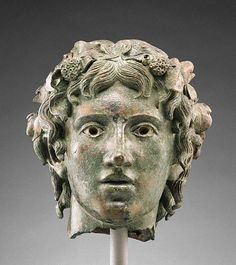 Head of the Young Bacchus  -  Unknown   Roman, A.D. 1 - 50   Bronze and silver   8 1/2 in.