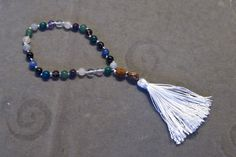 How to make a mala prayer bracelet. And tassels ;)