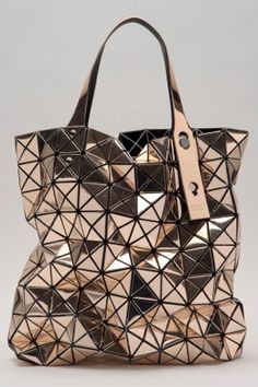 Geometric Fashion - metallic gold Prism Bag with flexible, functional surface design using connecting triangles over mesh // Bao Bao Issey Miyake