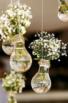 budget rustic wedding decorations flowers gypsophila in vases similar to light bulbs suspended on a rope colin cowie weddings #BrilliantInteriorPlanning