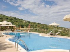 This property is equipped with shared 128m² swimming pool and has views over the beautiful hills and sea in the horizon.