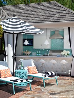 A Haute Outdoor Retreat | At Home Arkansas | March 2014 | Photographer: Nancy Nolan | Designer: Tobi Fairley @Tobi McDaniel Fairley #pool #bar #stripes #blackandwhite #umbrella #chaise #aqua #orange