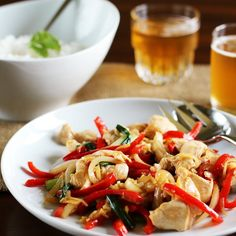 Thai Ginger Chicken Stir-Fry (Gai Pad Khing) Recipe Main Dishes with fish sauce, oyster sauce, sugar, canola, boneless skinless chicken breasts, garlic, green onions, red bell pepper, onions, fresh ginger, cooked white rice