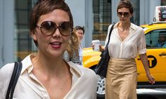 Maggie Gyllenhaal is retro chic in cream blouse and leather skirt