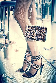 Saint Laurent leopard print Spike-Studded Ankle-Wrap Sandals and Monogramme Bag for aThursday girls night out.