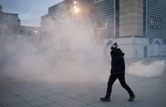 Kosovo police fire tear gas in protests against Serb minister