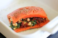 Put the raw stuffed salmon in the baking dish.