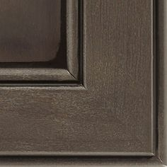 Thunder Black Glaze cabinet finish on Maple allows for most of the grain to show through, creating a deep brownish-grey coverage that has a naturally weathered wood look, topped with a true black glaze.