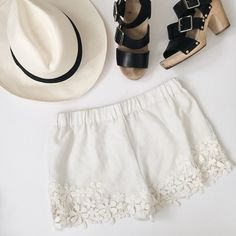 """White shorts with flower lace detail White shoes with crochet flower lace detail from Zara. Elastic waistband. Size small. Worn only once. Approx 27-33"""" waist and 10"""" in length. No trades, no pp, no exceptions!!! Zara Shorts"""