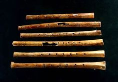 8,800 year old flutes unearthed from Jiahu site (Neolithic site of Peiligang culture, 5700-7000 BC), the oldest playable musical instrument with seven notes ever found, were discovered in China. If you go to the site they have wav files so you can hear someone playing the actual instruments!