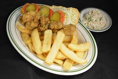 Oyster Po' Boy with the causeway's best cole slaw and fries!