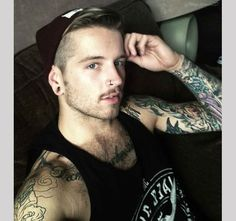we girls we love them suicide boys ! facebook them ! have some great photos of tattooed guys ;)